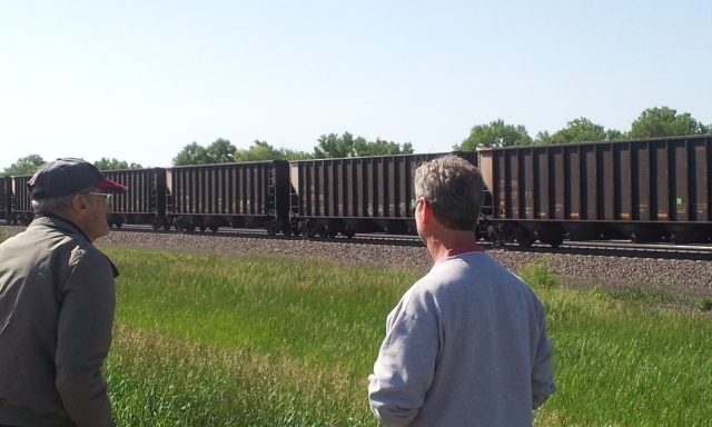 My Father and Brother observing a coal train east of Brady, Nebraska