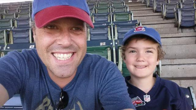 Tad Salyards and his son Marek at Wrigley Field.